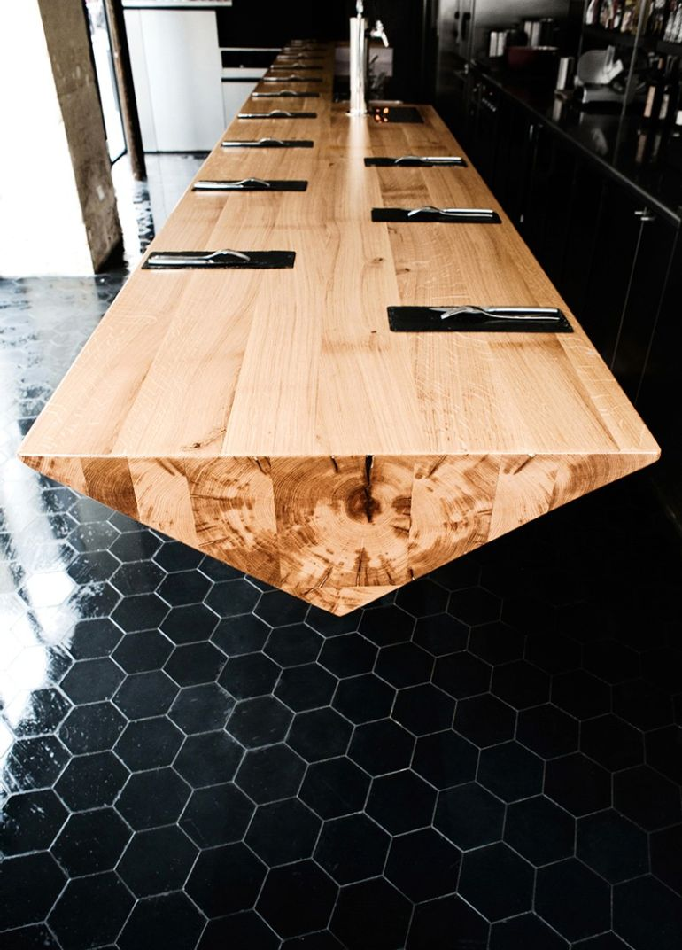 Atelier jmca designs stunning cantilevered wooden counter - Table bar industriel ...