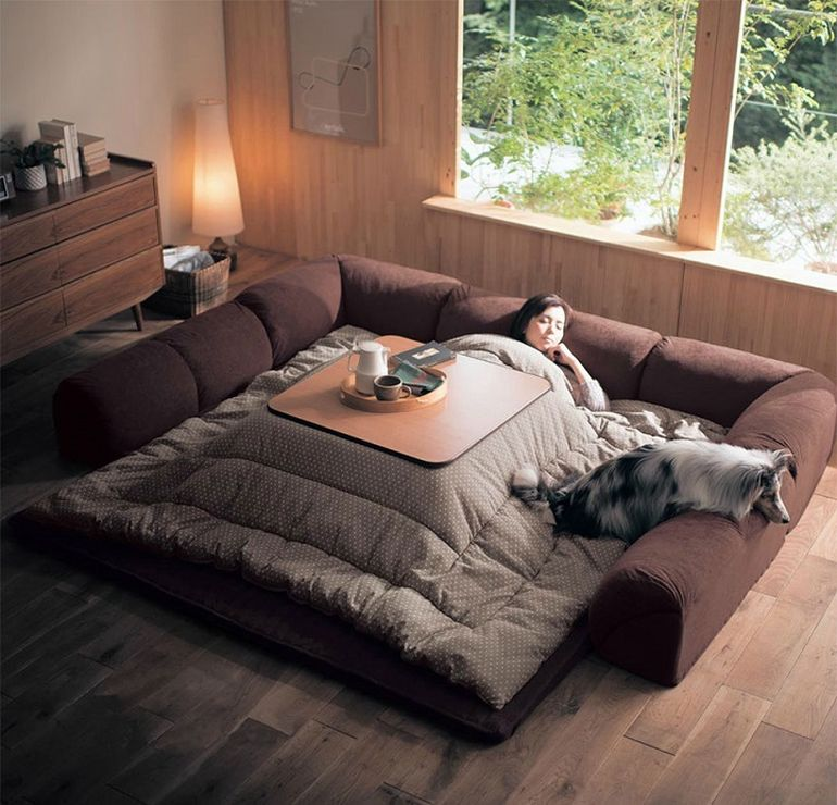 This Bed-Table-Couch Hybrid Keeps You Warm In The Winter-3