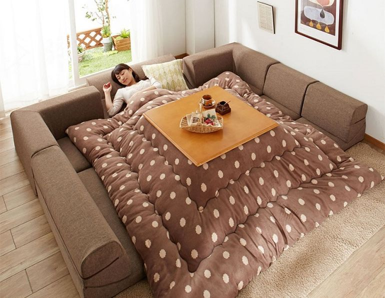 This Bed-Table-Couch Hybrid Keeps You Warm In The Winter-4