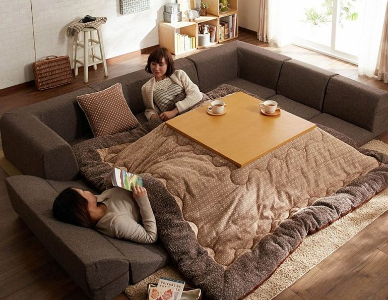 This Bed-Table-Couch Hybrid Keeps You Warm In The Winter-6