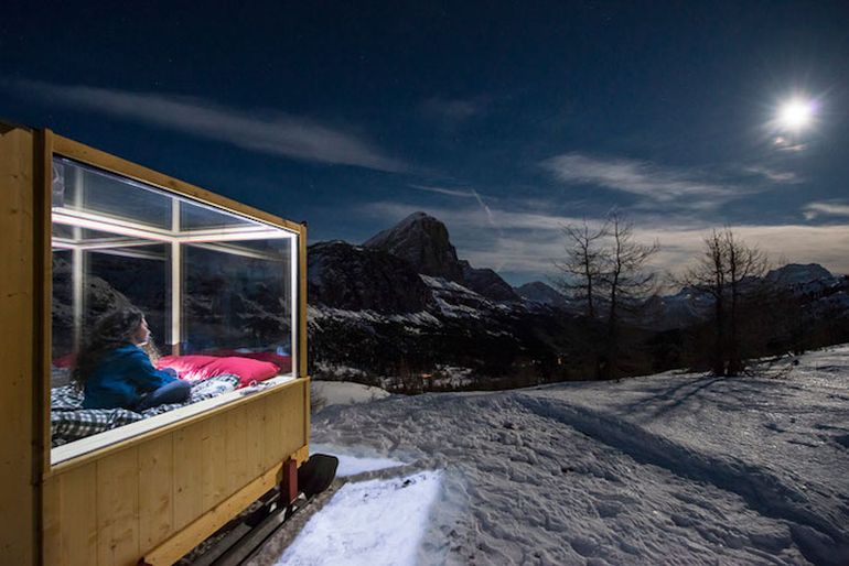 Wooden Cabin On Skis Offers Nighttime Views Of Mountains-2