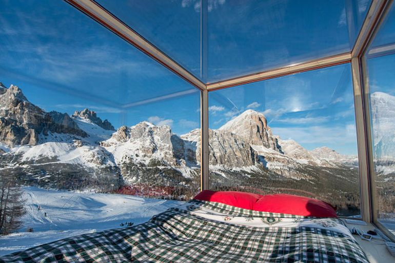 Wooden Cabin On Skis Offers Nighttime Views Of Mountains-3