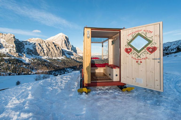 Wooden Cabin On Skis Offers Nighttime Views Of Mountains-4