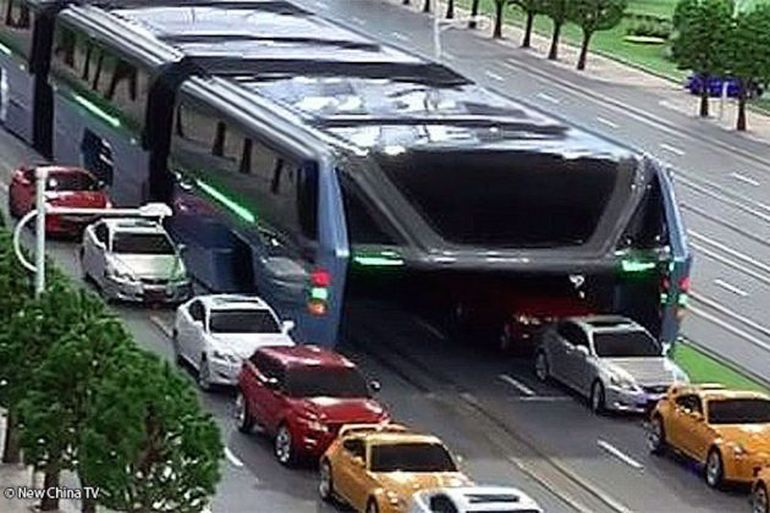 China Unveils Full-Sized Prototype Of Bizarre Traffic-Straddling Bus-1