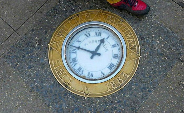 New York sidewalk features an embedded 130-year old clock