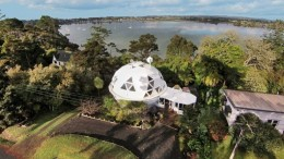 Last month, we talked about New Zealand's nature-inspired church built entirely from trees and plants. Well, this time around, the organic scope makes way for man-made wonderment in the form of the Dome House, located within a Paremoremo property (by the outskirts of Auckland). On closer inspection, one could identify the individual pieces of triangular panels that make up this geodesic dome. These were cut and assembled on-site (within a week), thus resulting in a purpose-built structure that fitted with the available floor and wall spaces. And as time is witness, the fabricated dwelling does hint at an engineering marvel of sorts, with the house surviving for almost 30 years while still maintaining its structural integrity. Auckland_Dome House_Geodesic_3 Interestingly, there is more to the Dome House than just its architectural uniqueness - and much of it relates to its inhabitants. That is because the 2,023 sq m (or 21,700 sq ft) geodesic dwelling was the home to late Helen 'Twink' McCabe and her partner Noel Fuller. 'Twink' McCabe was known for her dedication to cats, and as such even introduced two new cat breeds to New Zealand: ocicat and munchkin cat. This feline ambit is quite appropriately demonstrated by a boutique cattery that is situated next-door to the Dome House. Auckland_Dome House_Geodesic_4 Now, as for the current state of the Dome House, the residence is already sold to a new owner, by probably fetching a good price with its plywood exterior (complemented by a rimu interior) and fascinating form. And in case you are wondering about the interior design, do take a gander at some of the images below that aptly showcase the finesse of the previous home-owners. Auckland_Dome House_Geodesic_5Auckland_Dome House_Geodesic_6Auckland_Dome House_Geodesic_7Auckland_Dome House_Geodesic_8Auckland_Dome House_Geodesic_9Auckland_Dome House_Geodesic_2 Via: Stuff