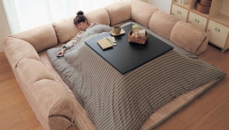 This Bed-Table-Couch Hybrid Keeps You Warm In The Winter-1
