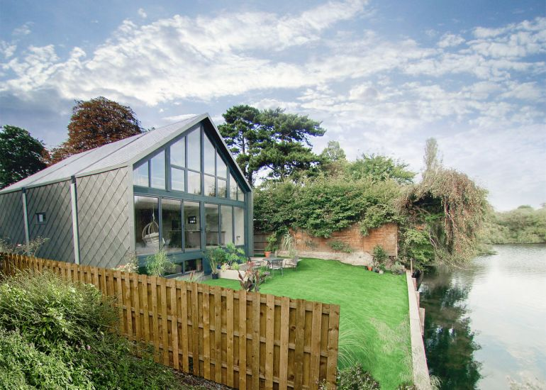 UK's Amphibious House Remains Afloat On Floodwater Like A Ship In Dock-2