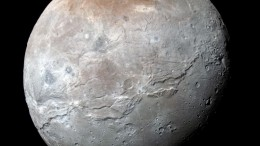 Pluto's largest moon Charon has deep chasms that may have been formed by an ancient ocean-3
